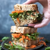 Avocado pesto chicken salad made with an easy homemade nut free pumpkin seed & avocado pesto, then piled on toasted bread for a delicious, healthy sandwich.