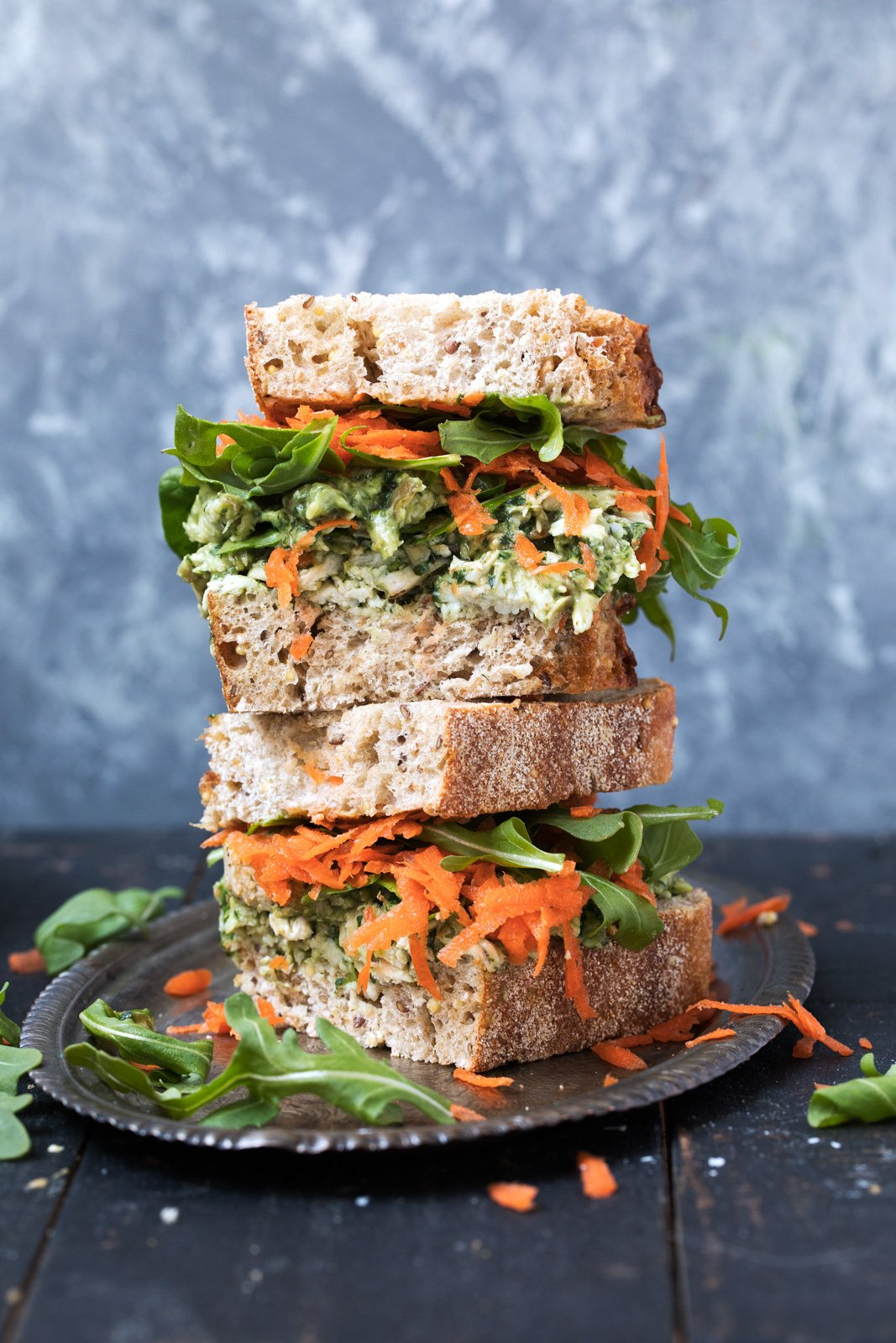 avocado pesto chicken salad sandwiches in a stack