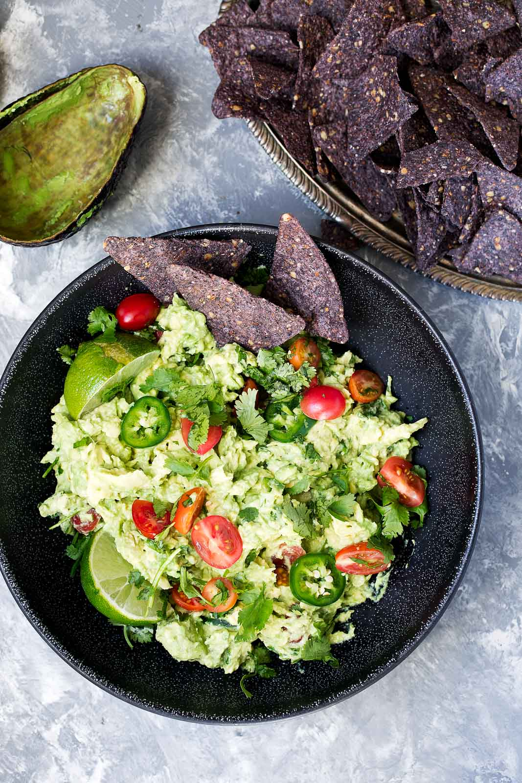 The best guacamole recipe EVER. A mix between creamy and chunky with bites of heat from jalapeno and flavor from cilantro and lime juice. You need this in your life!