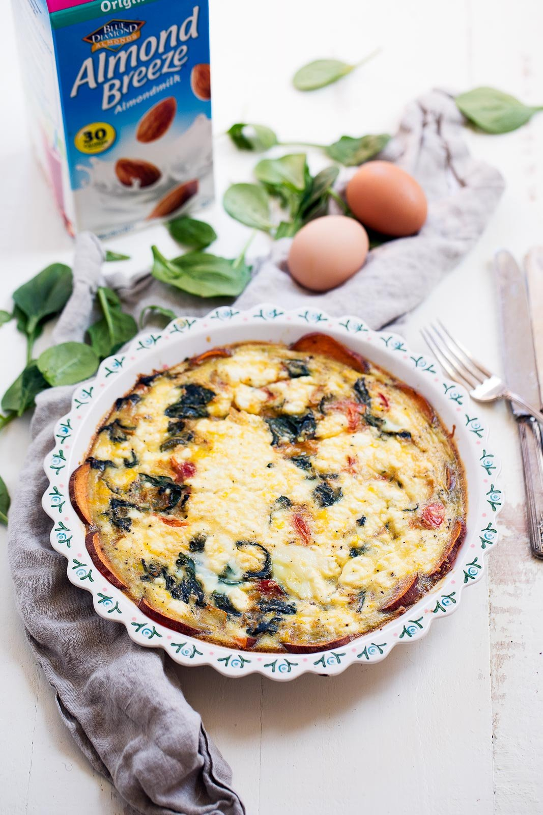 Spinach and goat cheese quiche made with a scrumptious sweet potato crust that helps to hold the quiche nicely together without all the calories of a regular crust. Gluten free!