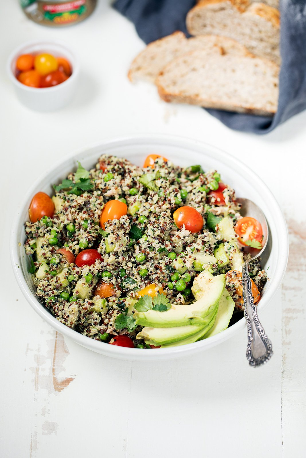 Tuna quinoa salad packed with protein, fresh spring veggies and a green goddess avocado dressing. Delicious and so easy to make!