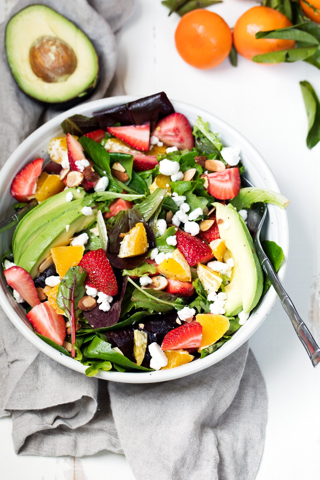 Gorgeous Strawberry Avocado Salad packed with heart-healthy fats, creamy goat cheese, toasted almonds and a light citrus poppyseed dressing. Like Panera's salad -- but so much better!