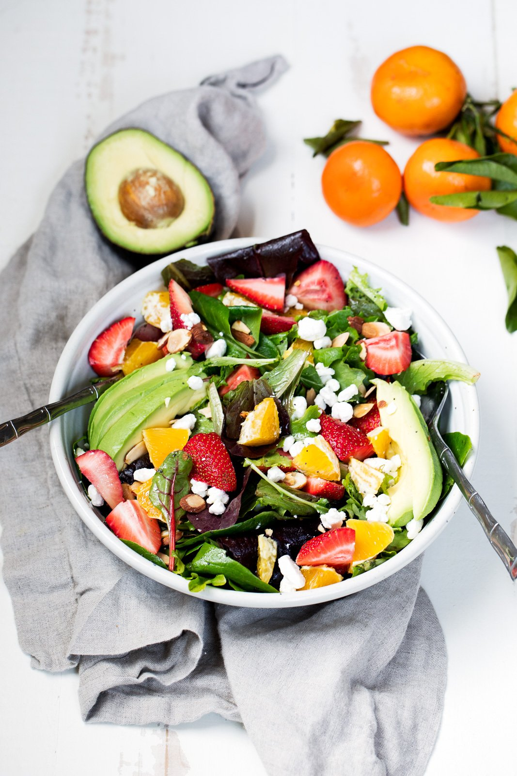 Strawberry Avocado Salad packed with heart-healthy fats, creamy goat cheese, toasted almonds and a light citrus poppyseed dressing. Like Panera's salad -- but so much better!