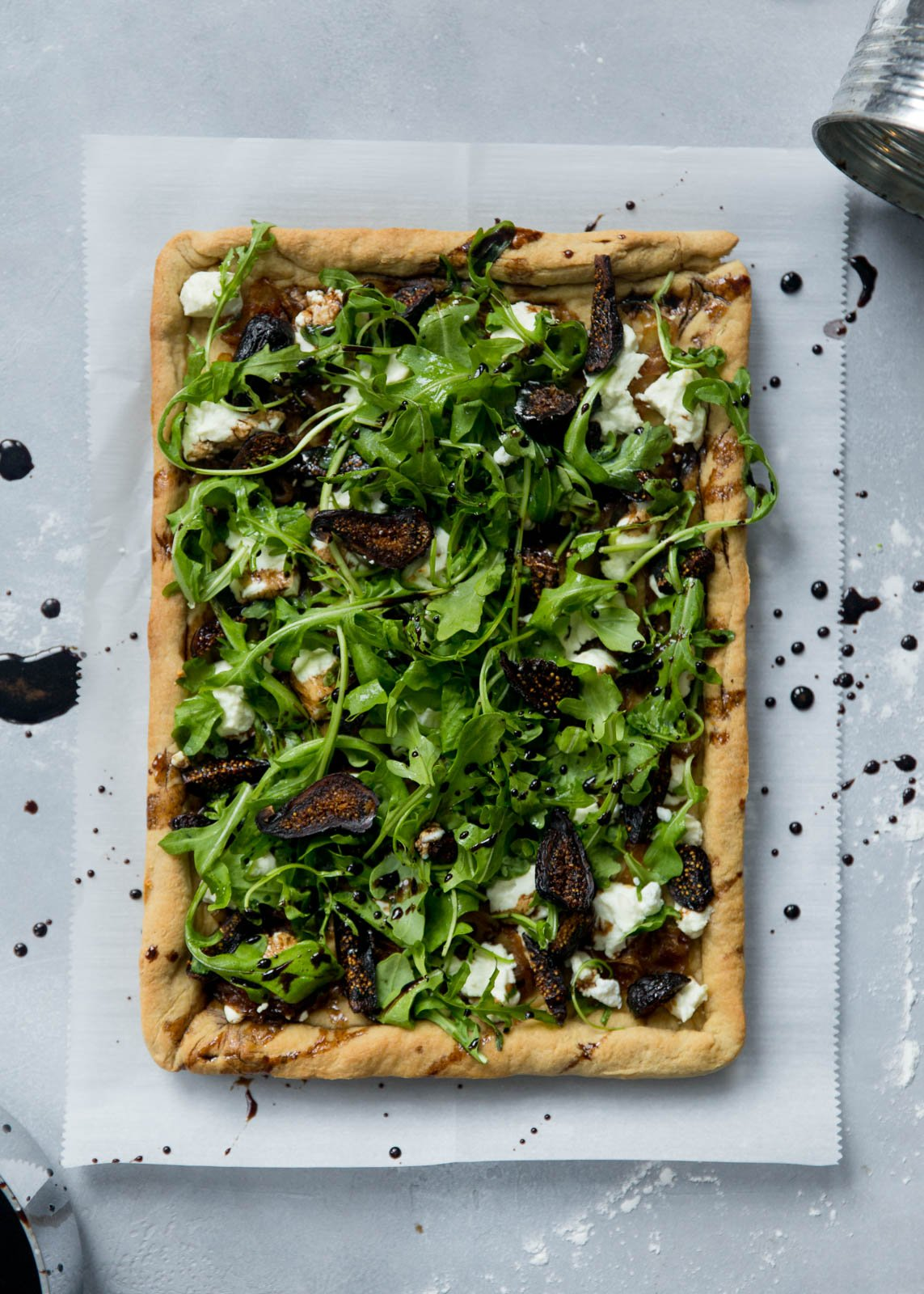 goat cheese pizza topped with with caramelized onion, goat cheese and figs