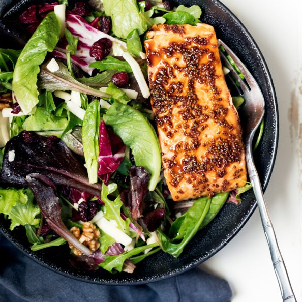 honey garlic salmon over a salad in a bowl