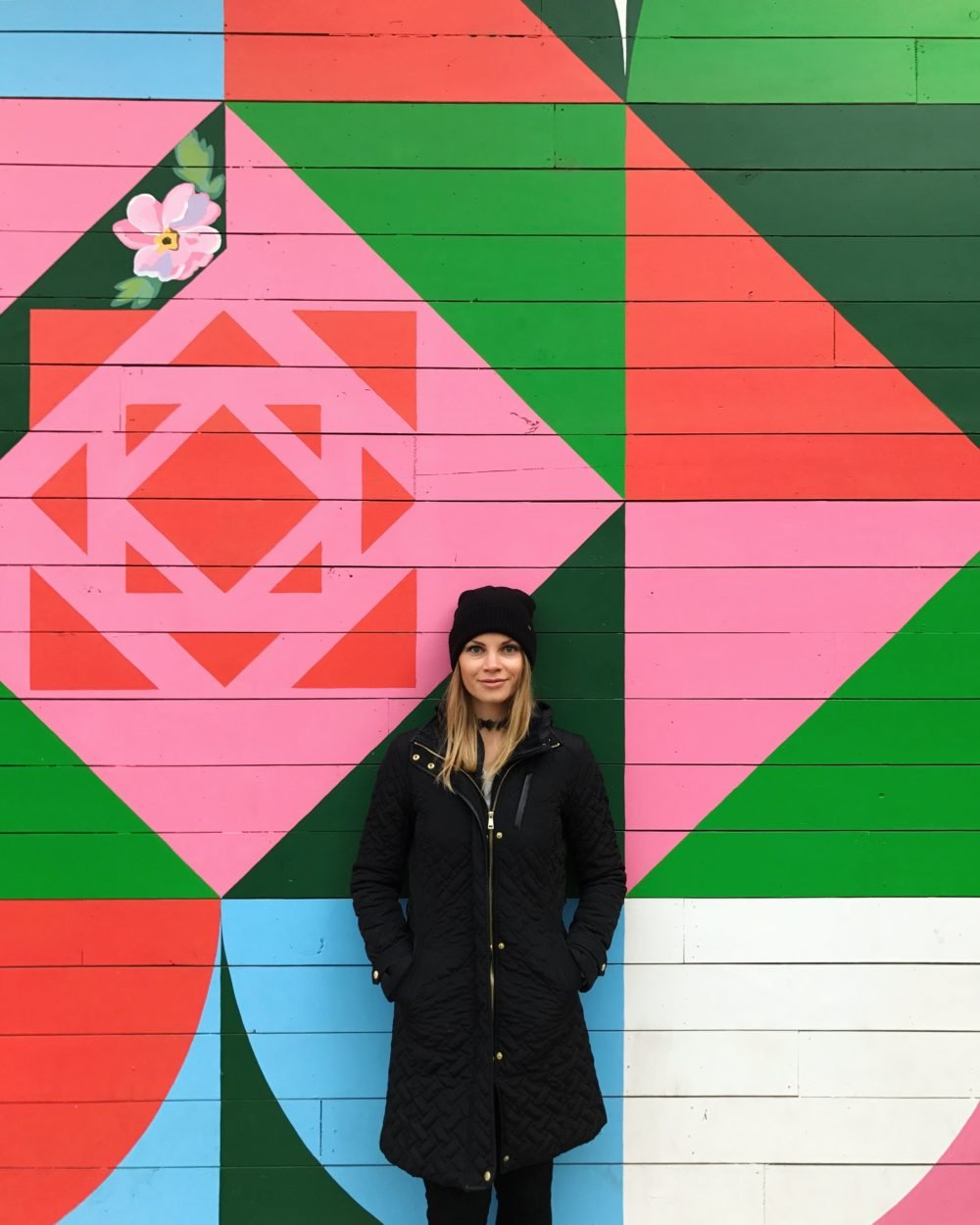 monique in front of a colorful wall