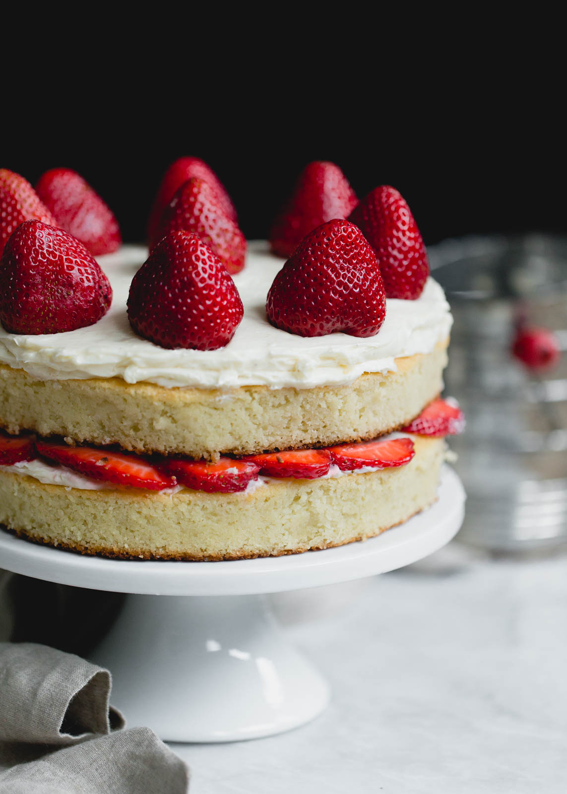 gluten free strawberry shortcake cake on a cake stand