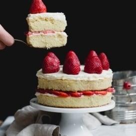 gluten free strawberry shortcake cake on a cake stand
