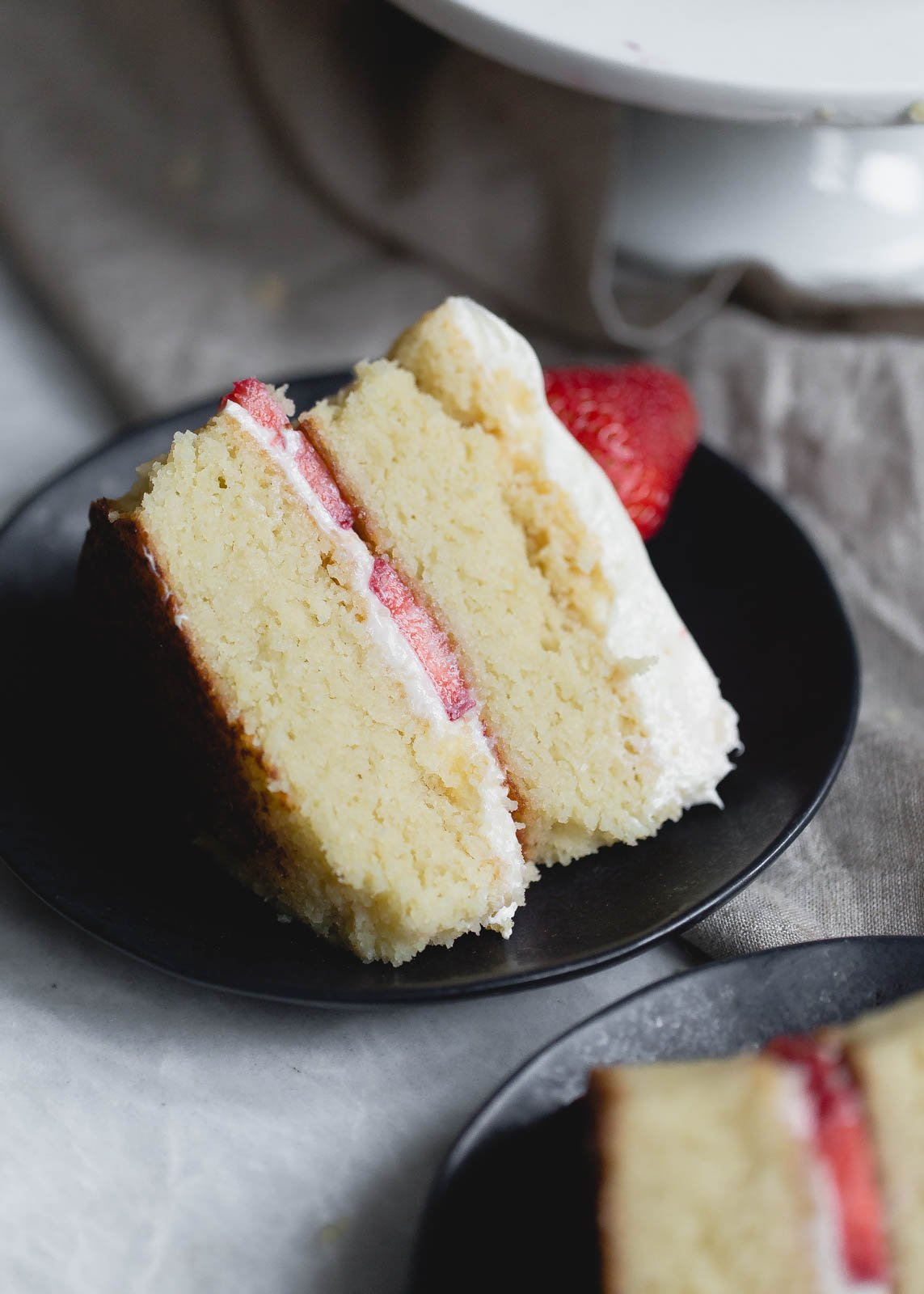 gluten free strawberry shortcake cake on a plate