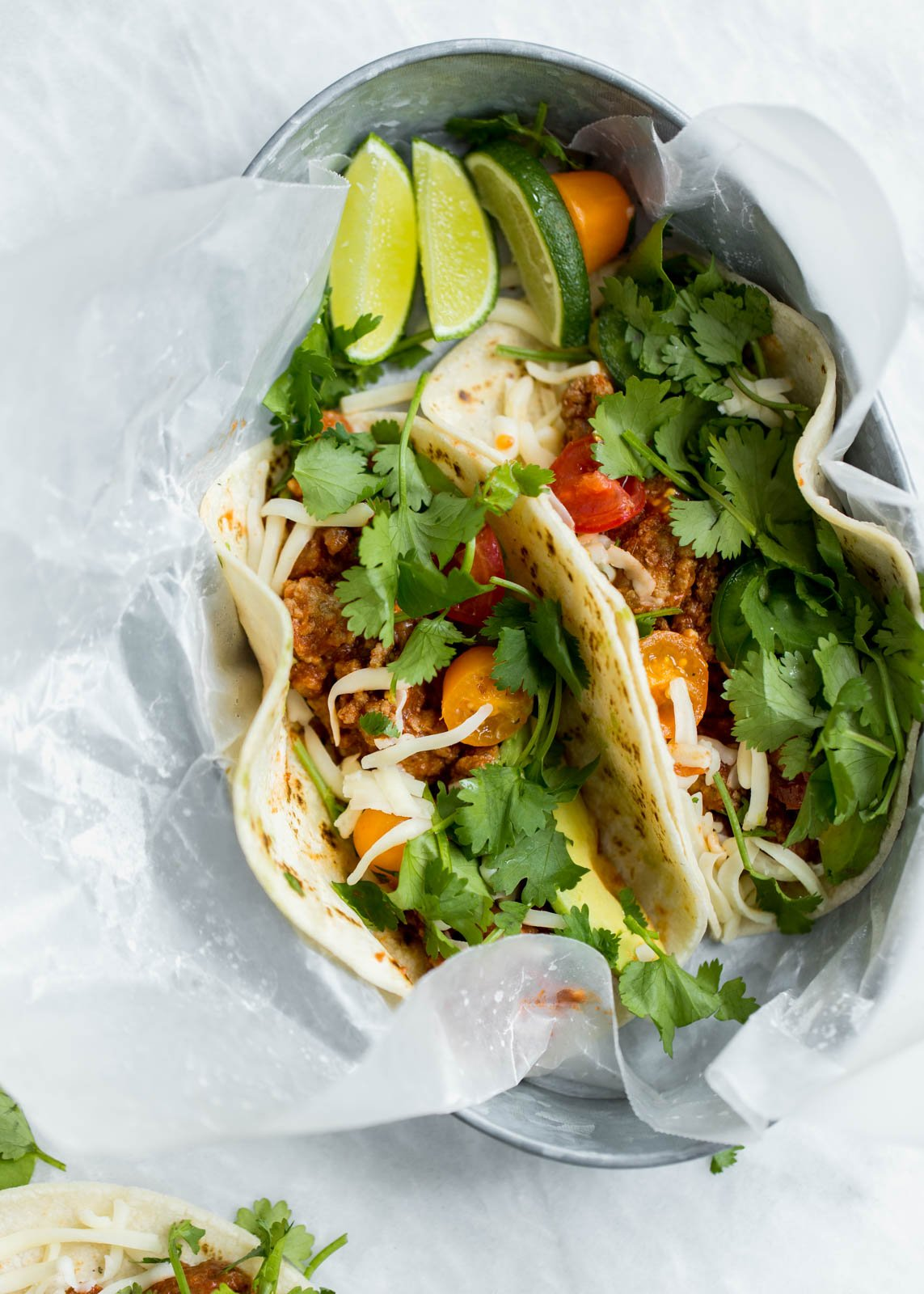 easy, healthy ground turkey tacos in a tin with parchment paper
