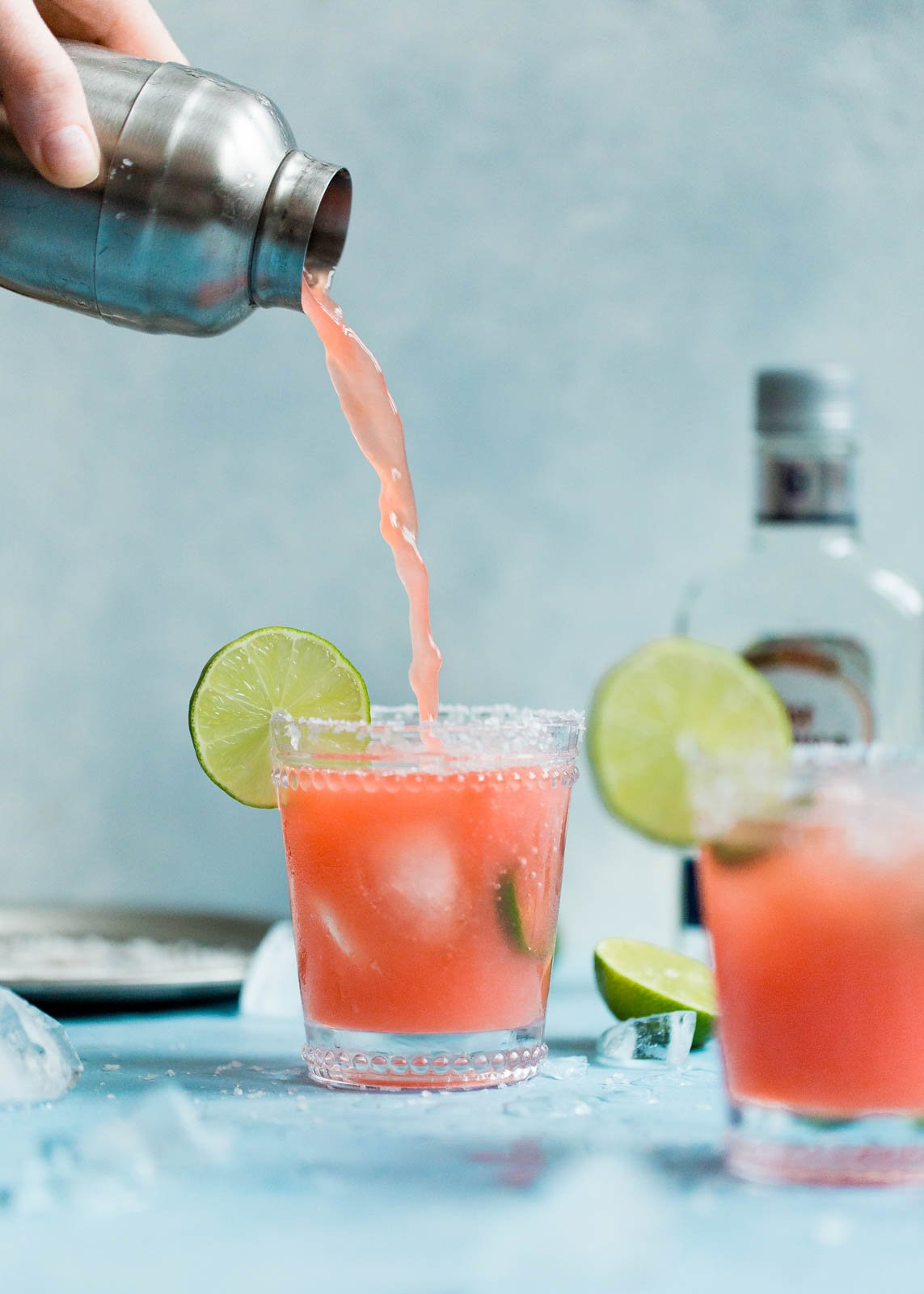 skinny watermelon margaritas being poured into a glass