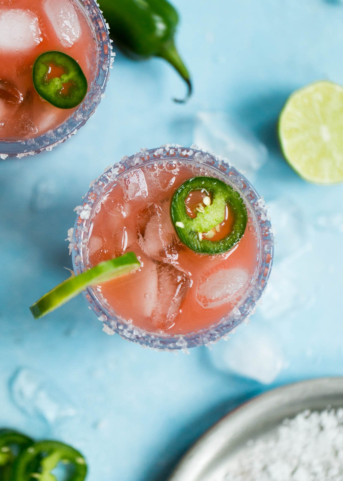 Skinny Jalapeño Watermelon Margaritas in two glasses with jalapeño slices