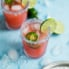 Skinny Jalapeño Watermelon Margaritas in two glasses with lime and jalapeño slices