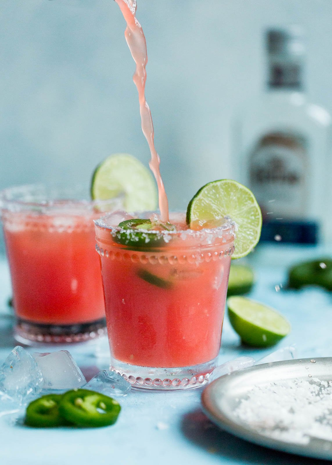 spicy watermelon margarita being poured into a glass