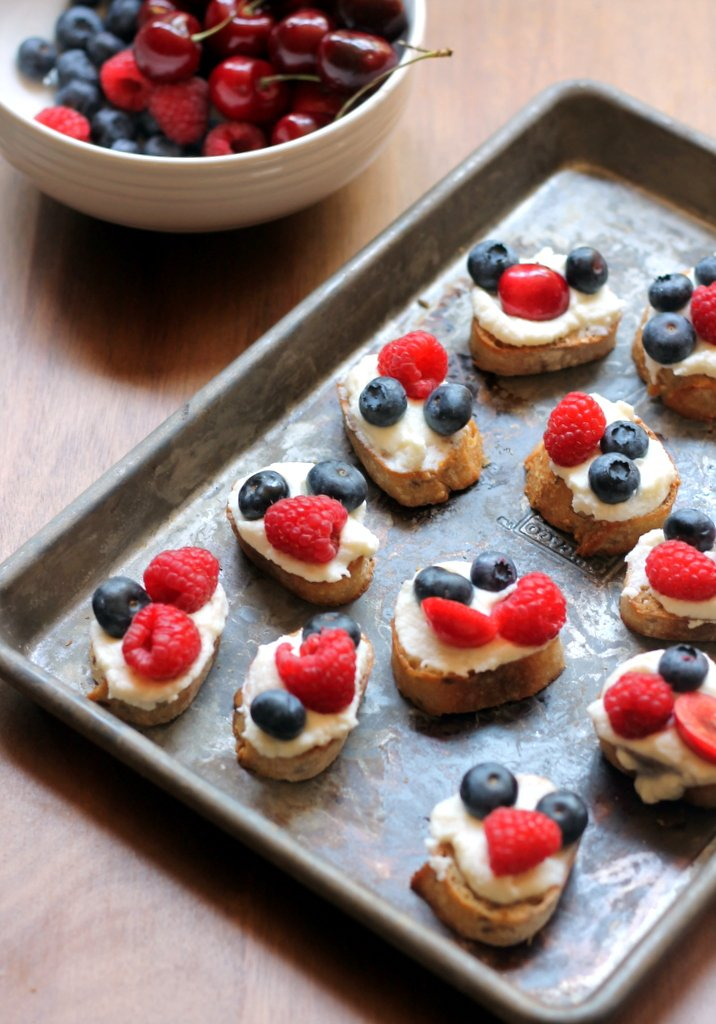 berry crostini on a baking sheet