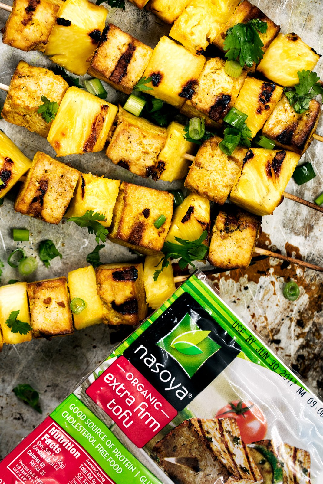tofu kabobs next to a package of tofu
