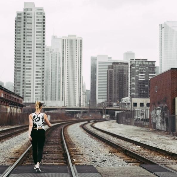 monique walking on train tracks