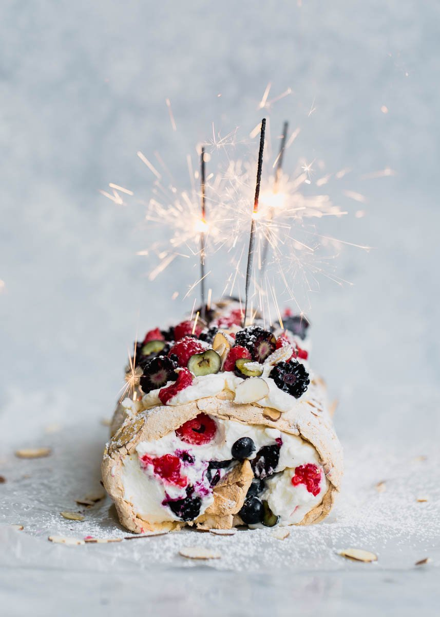 meringue cake with sparklers on top