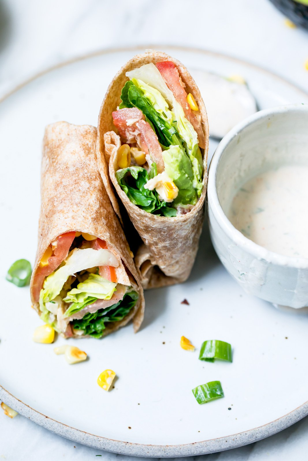 Easy, flavorful tuna wraps drizzled with light chipotle Greek yogurt ranch dressing. They're the perfect summertime lunch and packed with delicious farmer's market veggies.