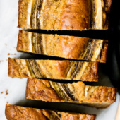 Amazing low fat healthy banana bread made with whole wheat flour, coconut oil, protein packed greek yogurt and naturally sweetened with a touch of pure maple syrup. Everyone loves this bread because it can easily be made into muffins too!