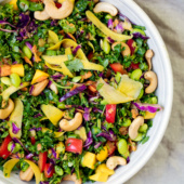 Vegan and gluten free chopped Thai Kale Salad with edamame, mango and veggies. Tossed with a flavorful peanut ginger dressing. The perfect lunch or picnic salad.
