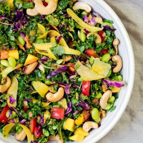 thai kale salad in a bowl