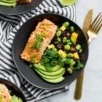 salmon bowls with avocado, rice, and mango