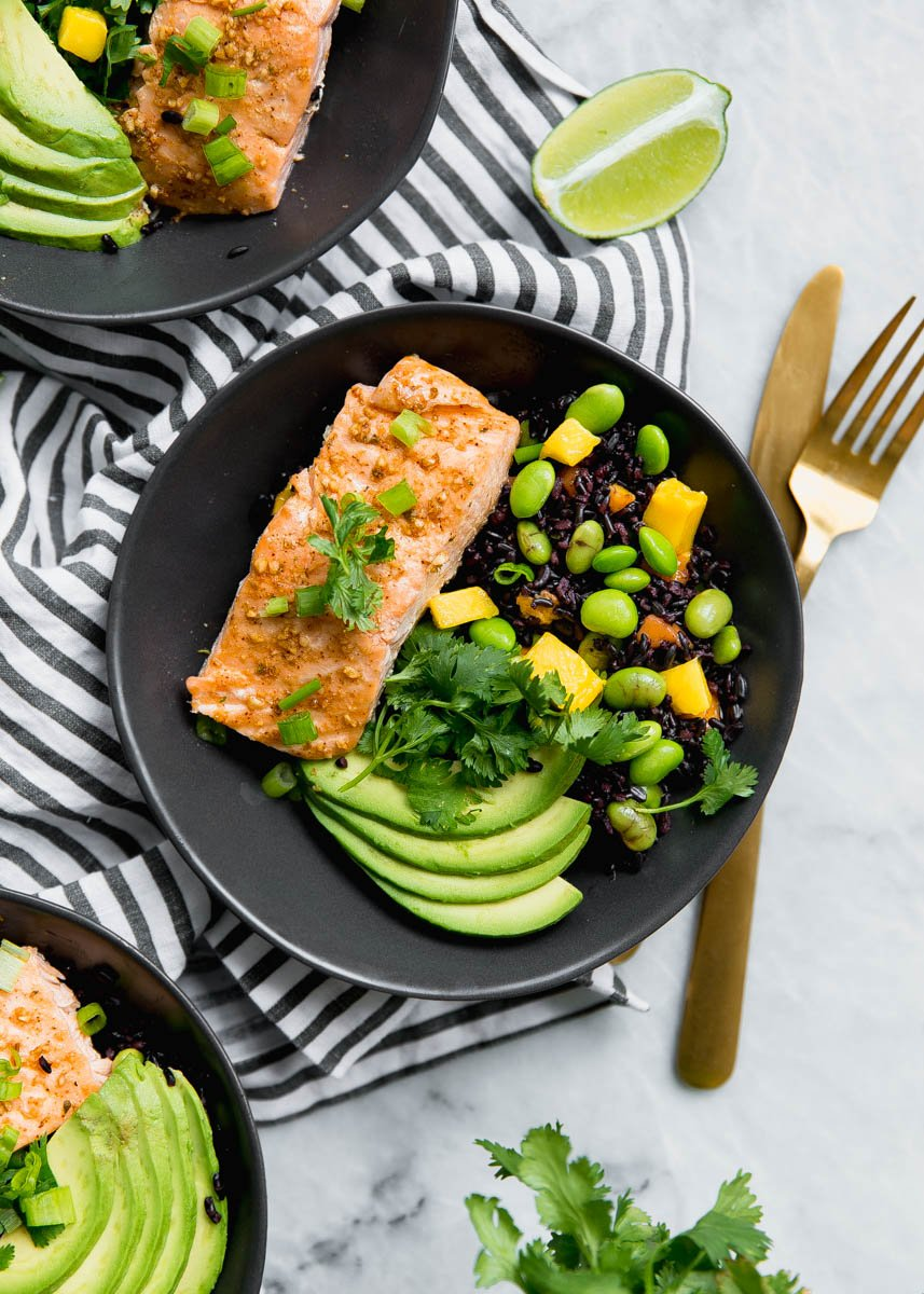 healthy salmon recipes: salmon, avocado, salsa, and black rice in a bowl