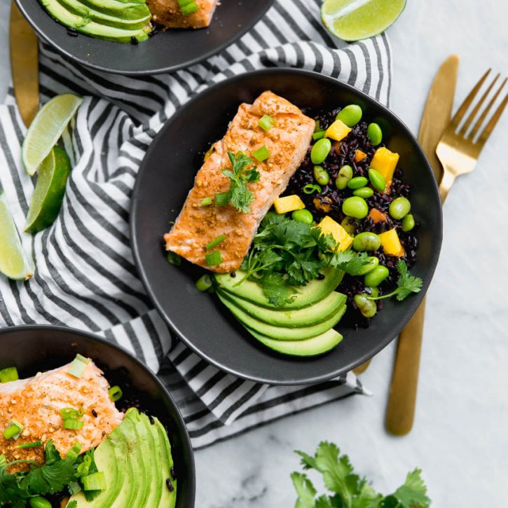 Delicious and easy 30 minute dinner for two: Chili Maple Lime Salmon Bowls with amazing mango & edamame mixed with sweet forbidden rice.