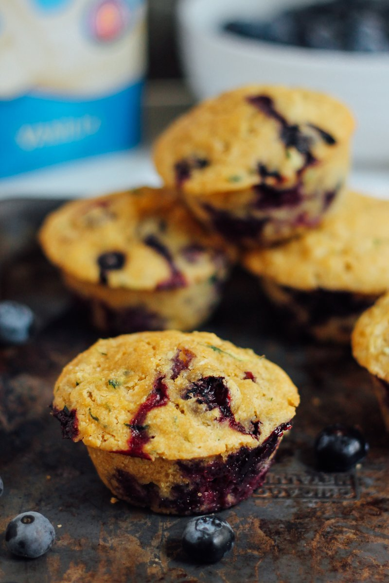 Healthy Cornbread Muffins bursting with fresh blueberries. These are sweetened with a touch of maple syrup and deliciously moist thanks to zucchini!
