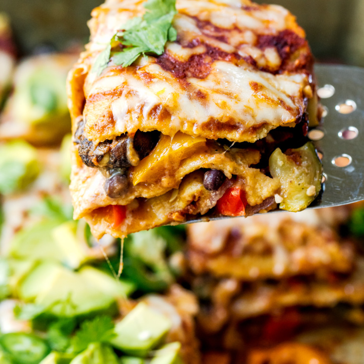 Layers upon layers of veggies snuggled between black beans, corn tortillas, a homemade chipotle enchilada sauce and cheese. The best and easiest vegetarian enchilada casserole!