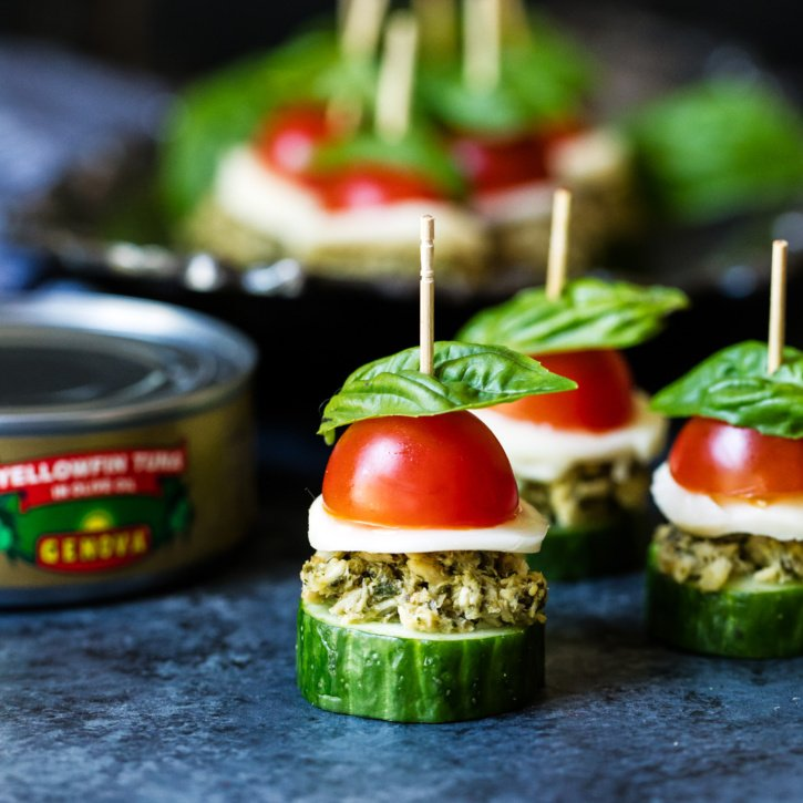 Quick and flavorful cucumber bites topped with delicious pesto flavored Genova tuna, fresh tomato and basil, creamy mozzarella, and a drizzle of homemade balsamic reduction. These little Caprese bites are light, healthy, and perfect for entertaining!