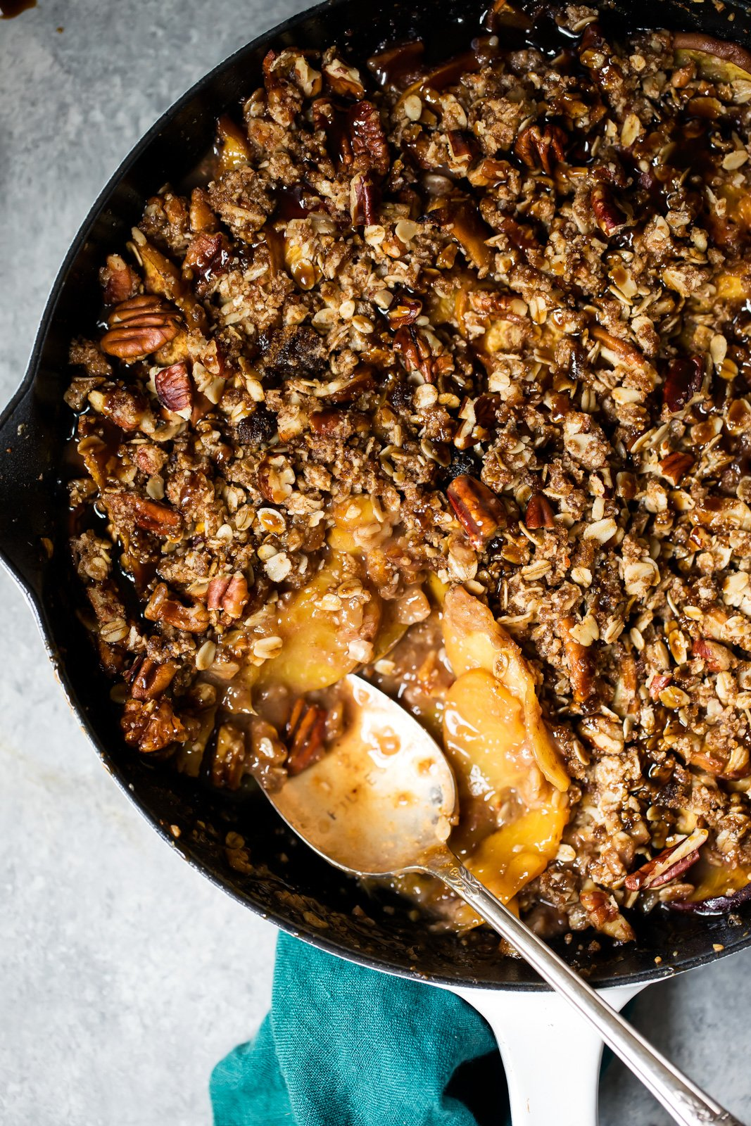 Juicy gluten free peach crisp with a crunchy pecan oat topping and a drizzle of the easiest homemade dairy free caramel. You're going to LOVE this summertime dessert. Don't forget the ice cream!