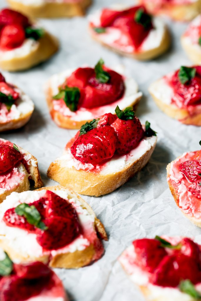 strawberry crostini on parchment paper