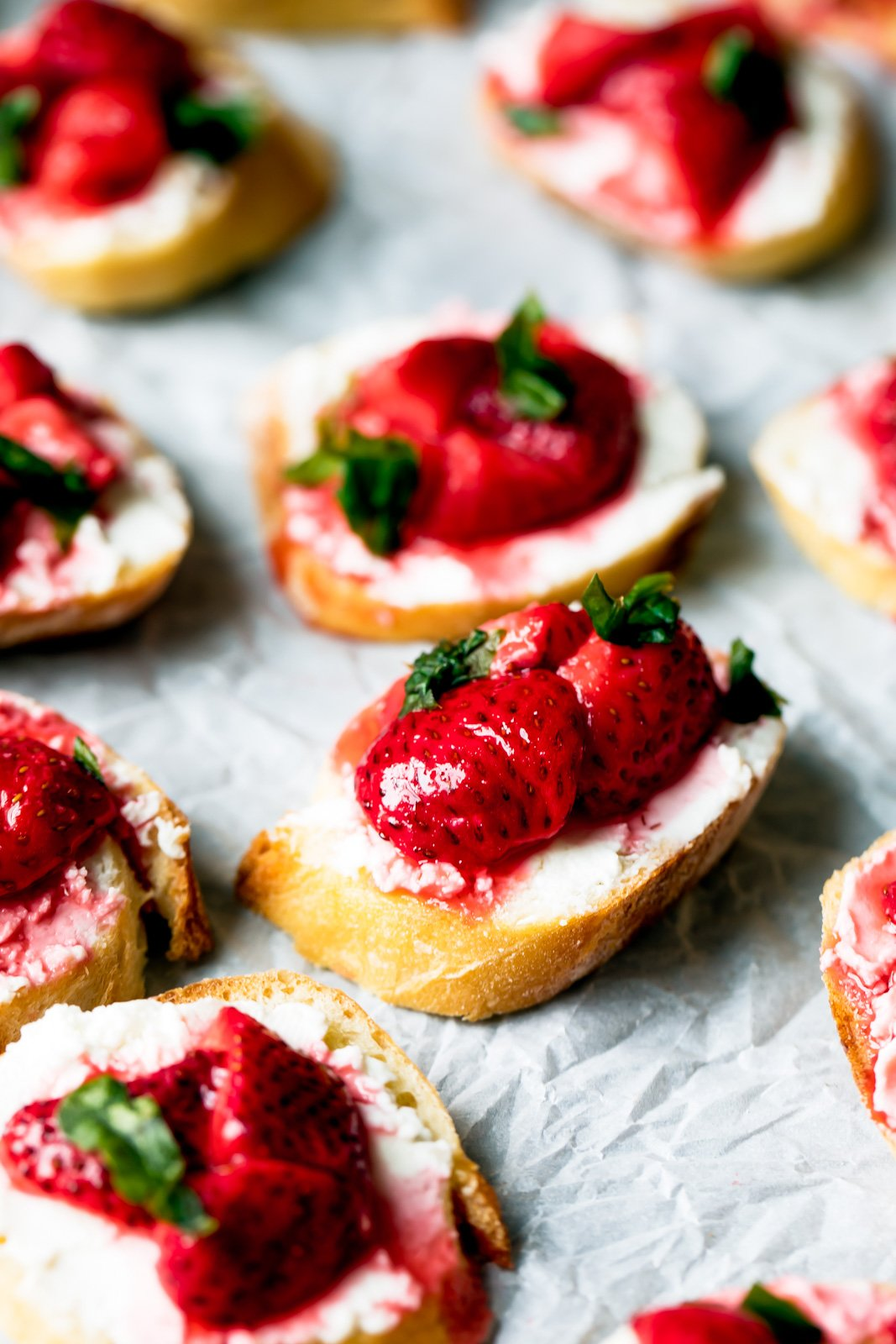 Gorgeous roasted strawberries paired with creamy goat cheese and fresh basil on top of crispy crostini. An incredible summer appetizer that's perfect for entertaining!