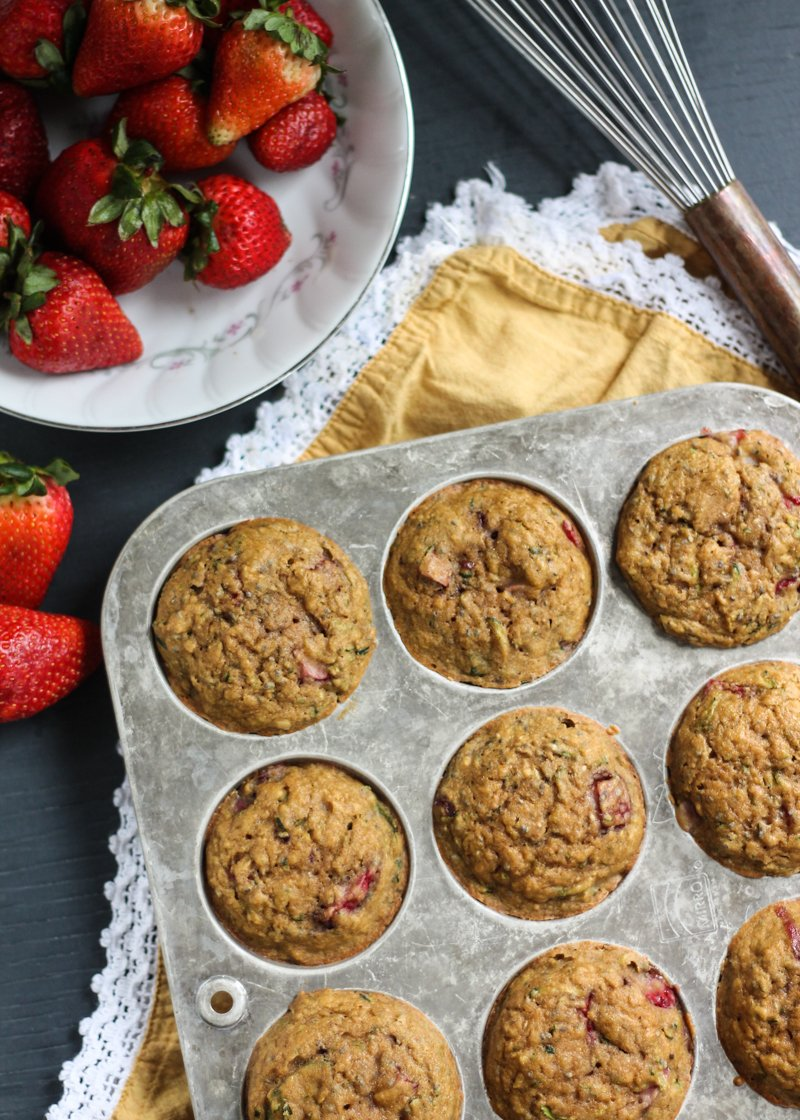 Nutritious and healthy whole grain strawberry zucchini muffins with a hint of lemon and a little crunch from chia seeds. Naturally sweetened and amazingly delicious!