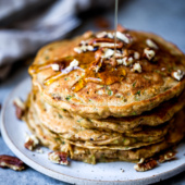 Fluffy whole wheat zucchini bread pancakes on a plate