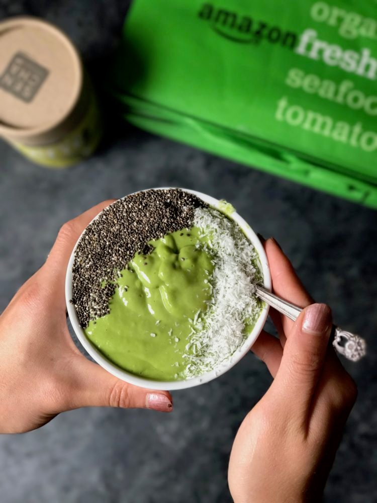 green smoothie bowl with coconut shreds and chia seeds