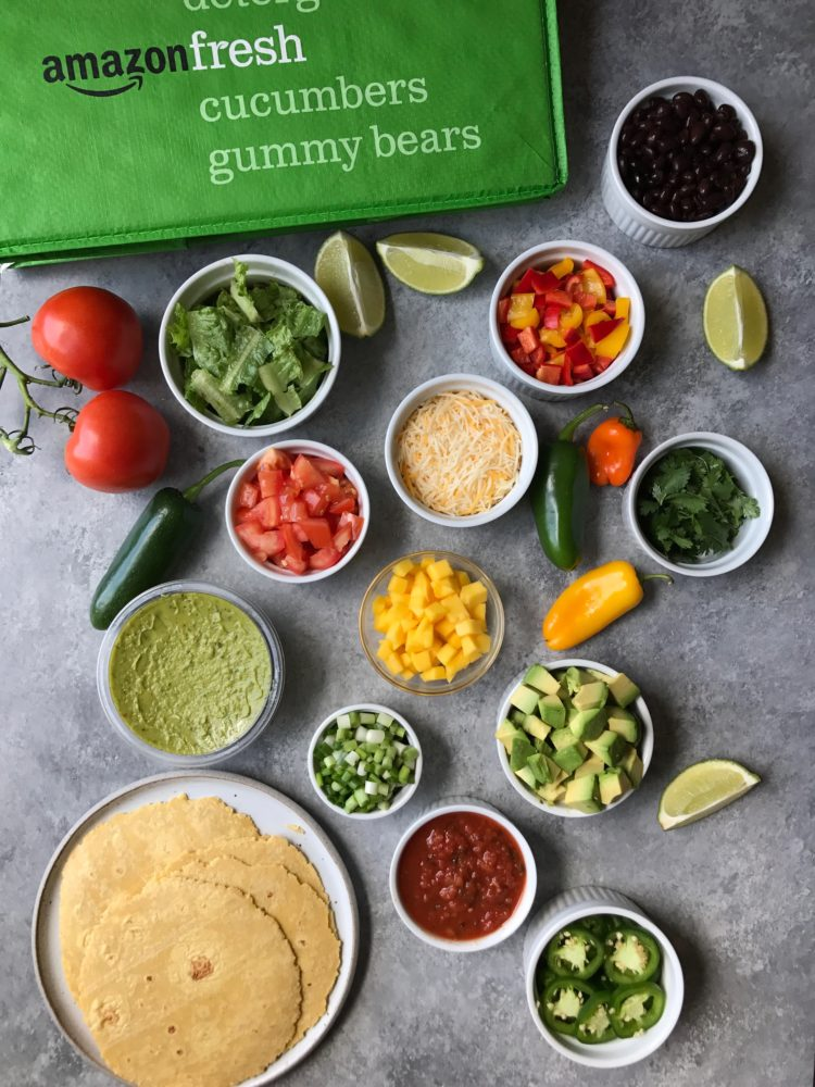 ingredients for a taco bar laid out on a board