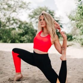 monique doing yoga in the sand
