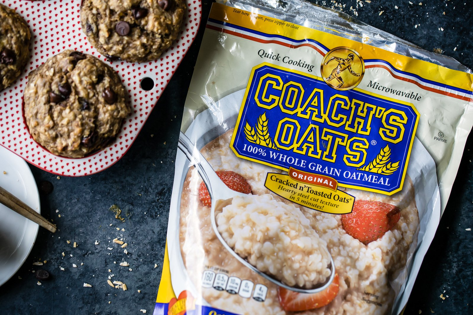 Fluffy and delicious banana oatmeal muffins made with wholesome ingredients like Coach's Oats, Greek yogurt, and flaxseed meal. They're perfect for a quick breakfast or snack on-the-go!