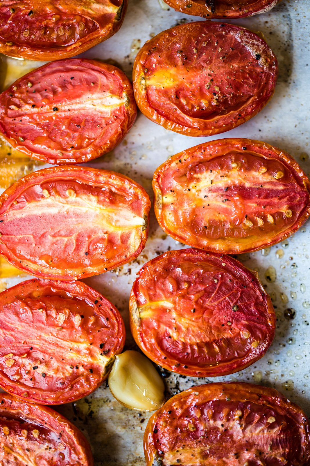 roma tomatoes on a sheet pan to make homemade roasted tomato basil soup