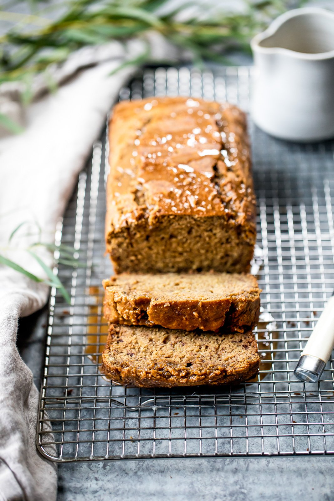 Healthy chai banana bread that will have your house smelling cozy and delicious. Topped with a simple cashew vanilla glaze!
