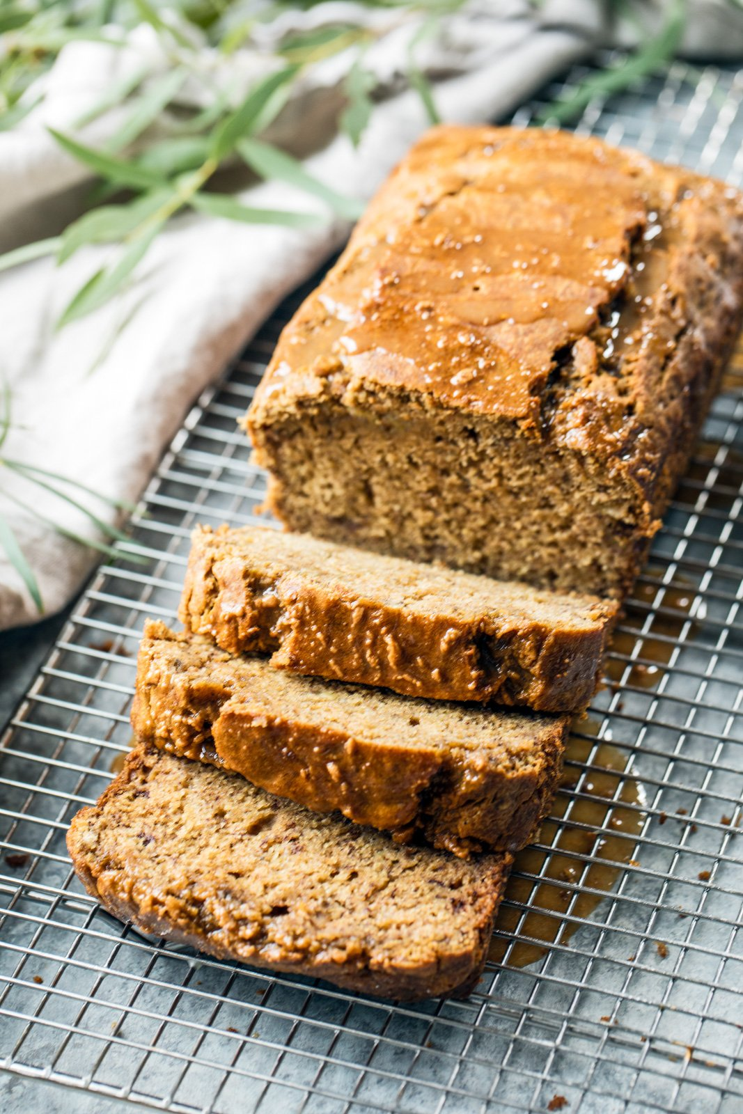 Healthy chai banana bread sliced on a wire rack