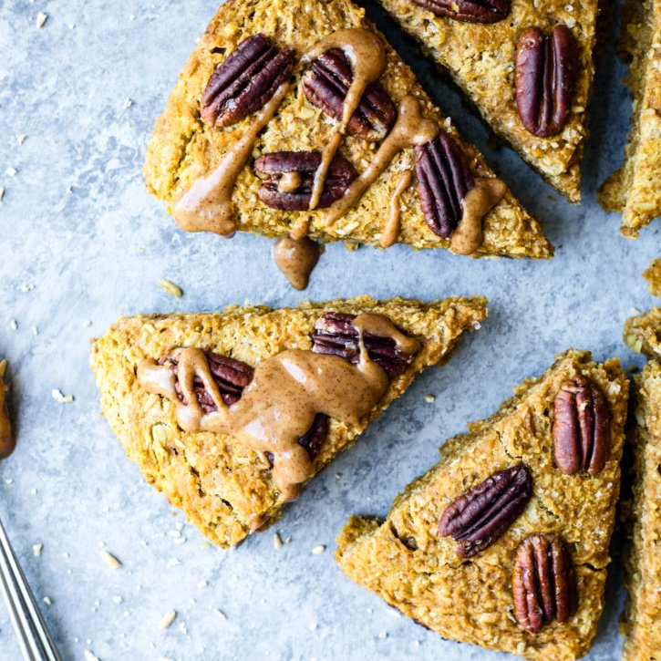 Fall-inspired vegan pumpkin scones with hints of maple, pecan and pumpkin spice in every bite! Made with hearty Coach's Oats for a wholesome, filling snack to pair with your cup of coffee.