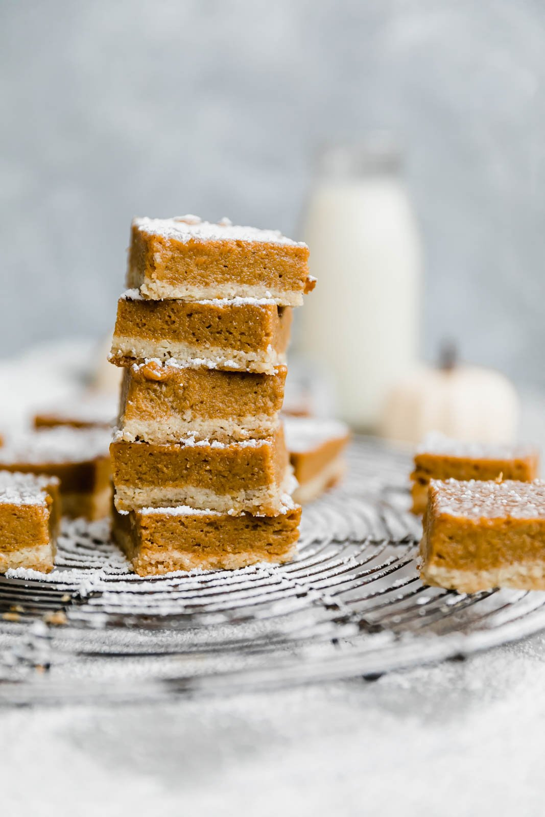 stack of paleo pumpkin pie bars on a wire rack