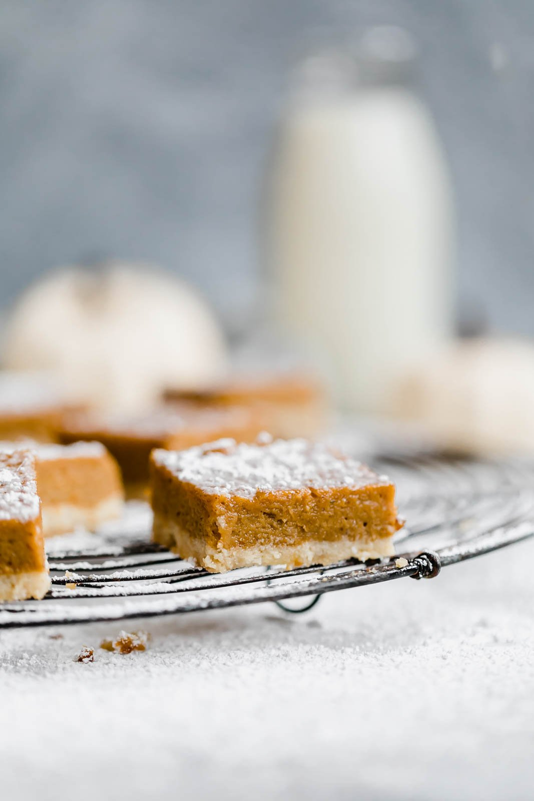 paleo pumpkin pie bars on a wire rack
