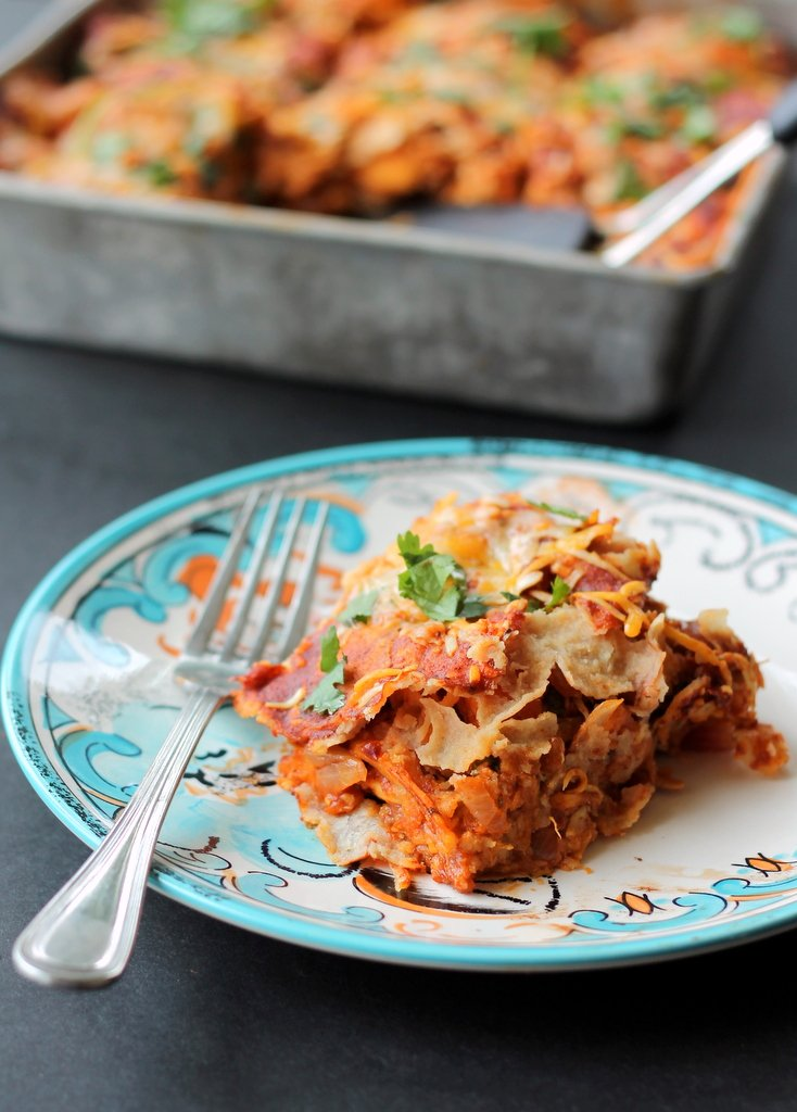 sweet potato enchilada on a plate with a fork