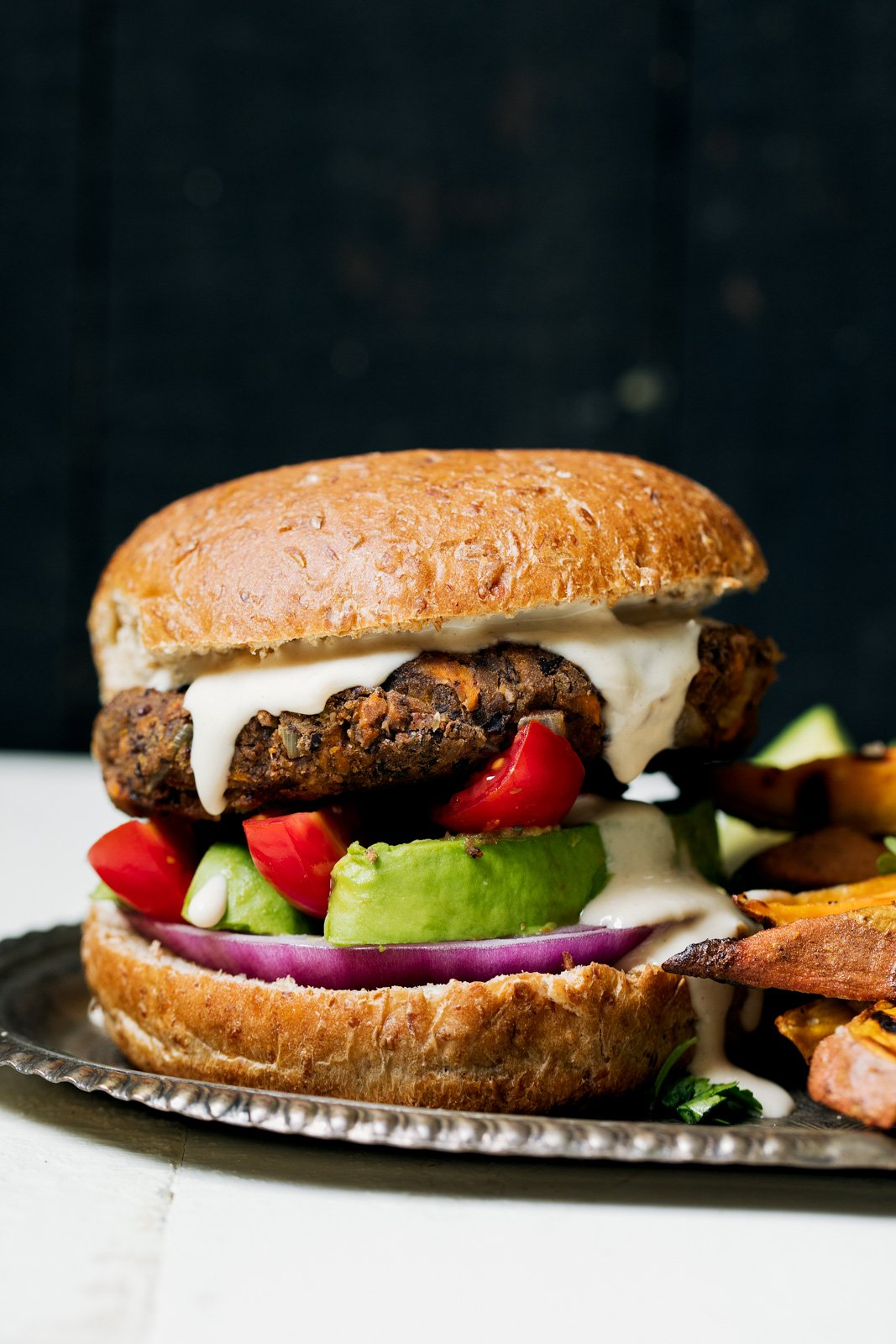 healthy recipes using tahini: black bean burger with tahini garlic cream sauce