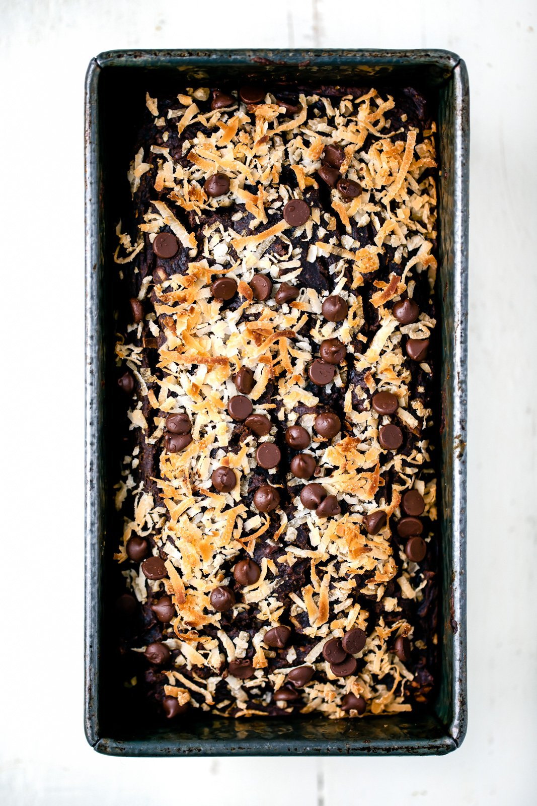 coconut double chocolate pumpkin bread in a loaf pan